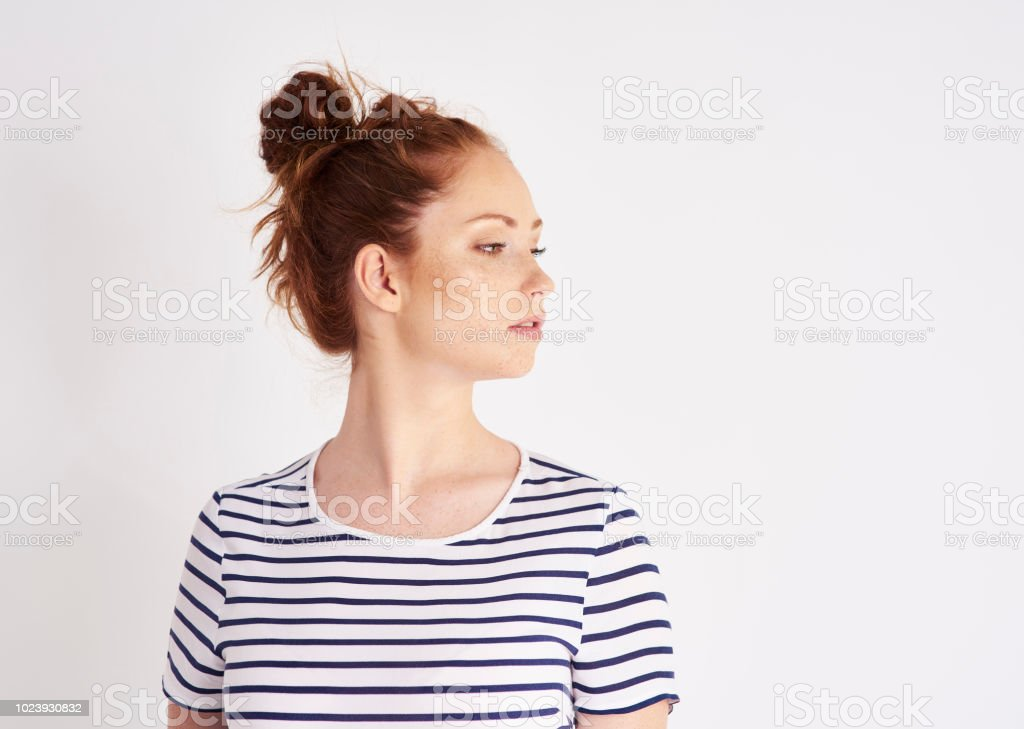 Resentful woman at studio shot stock photo