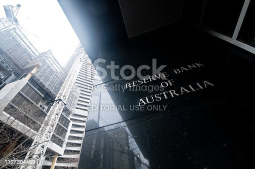 MELBOURNE, AUSTRALIA - JULY 26, 2018: Reserve Bank of Australia name on black granite wall in Melbourne Australia with a reflection of high-rise buildings. The RBA building is located at 60 Collins St, Melbourne VIC 3000 Australia.