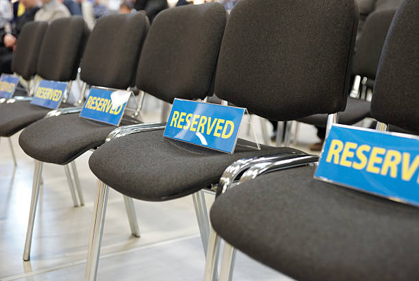 Reserved chairs in conference hall stock photo