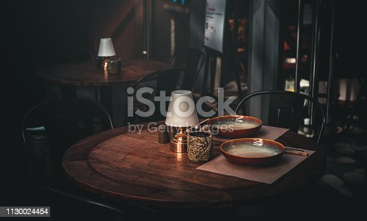 647209792 istock photo Reserved dining table in vintage style, Restaurant outdoor 1130024454