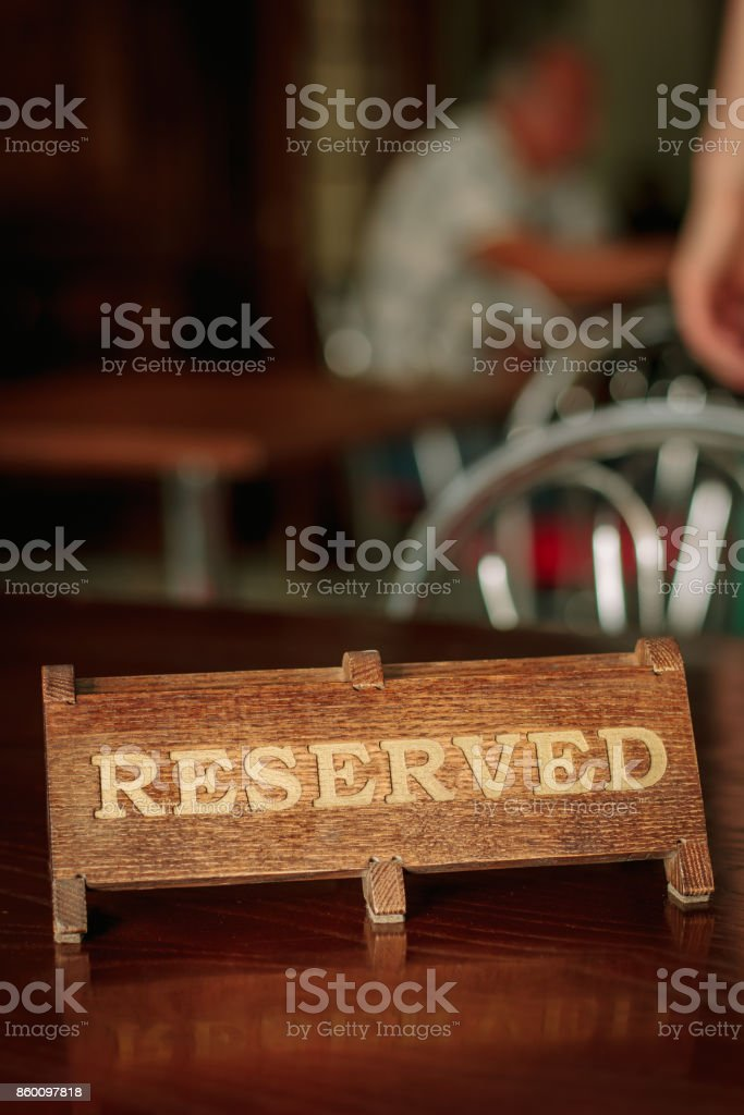 Reserved plate on table on a restaurant or cafe stock photo