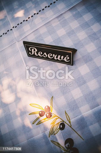 Closeup view on reserve title on restaurant table.