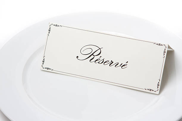 Reserved sign in french on plate stock photo