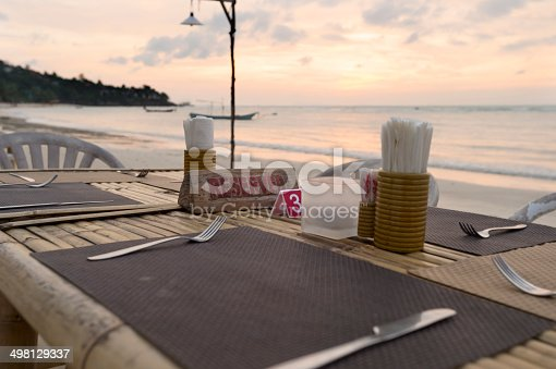 istock Reserved sign on a table at a beach restaurant 498129337