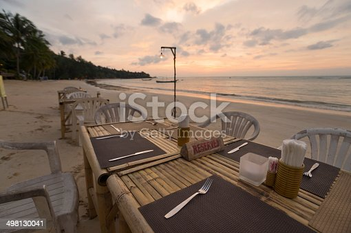 istock Reserved sign on a table at a beach restaurant 498130041