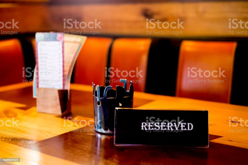Reserved sign on a table in cafe stock photo