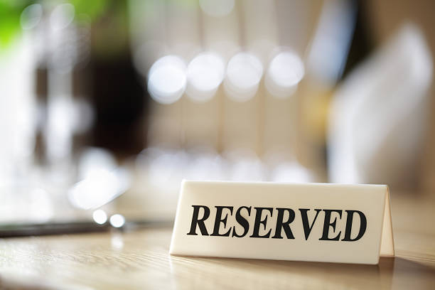 reserved sign on restaurant table - native american reservation stock photos and pictures