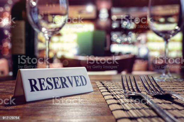 Reserved sign on restaurant table with bar background picture id912129754?b=1&k=6&m=912129754&s=612x612&h=ybfdqkbv869zkbsqpsc0w5kaidvyjn115tegorwdvew=