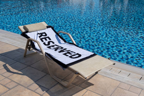 Reserved sun lounger by the pool stock photo