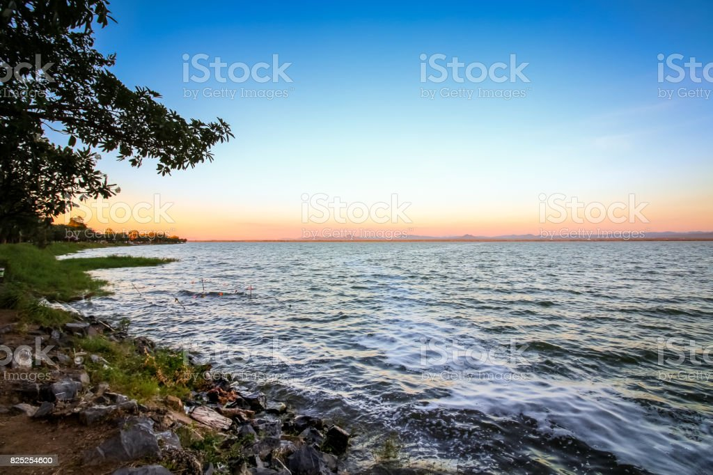 Reservoir at Pa-sak Jolasid River Dam at dawn twilight, Lopburi, Thailand. stock photo