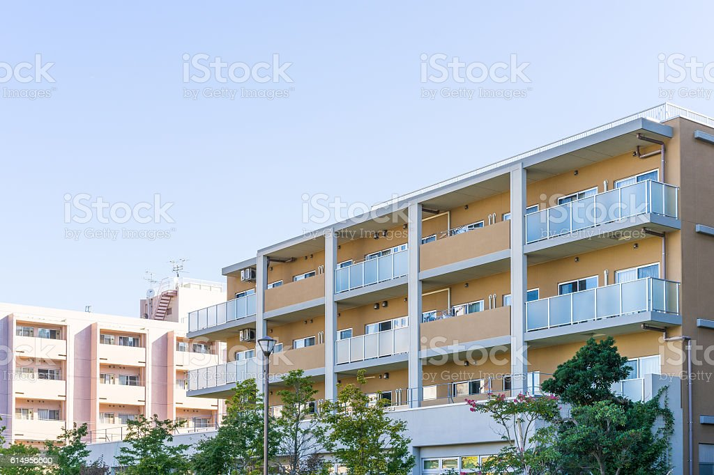 Residence image, apartment building against blue sky ストックフォト