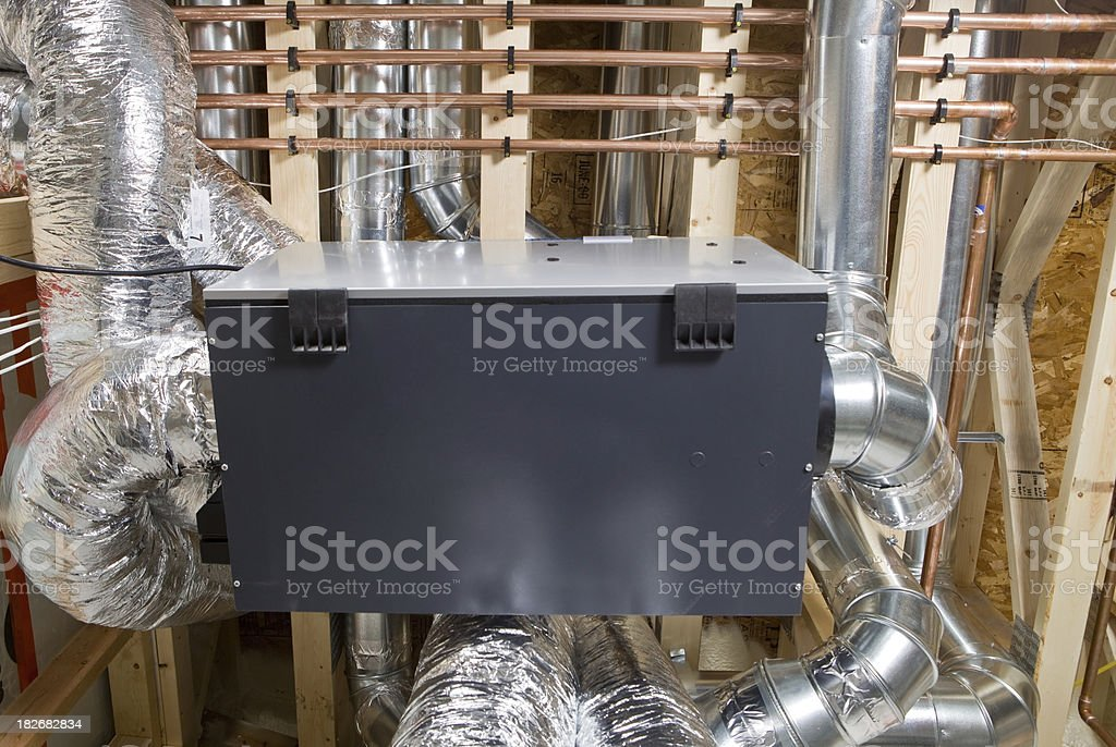 Residential Air Exchanger with Complex Duct Work stock photo