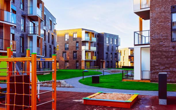 Residential apartment house building exterior children playground reflex stock photo