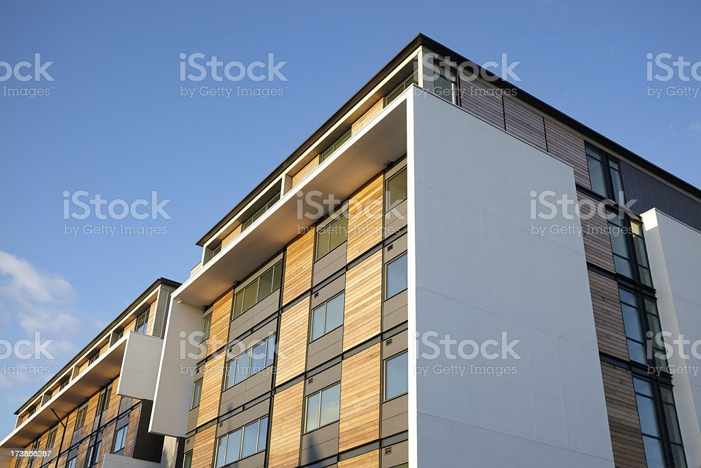 Residential Apartment with wood panels and blue clear sky royalty-free stock photo