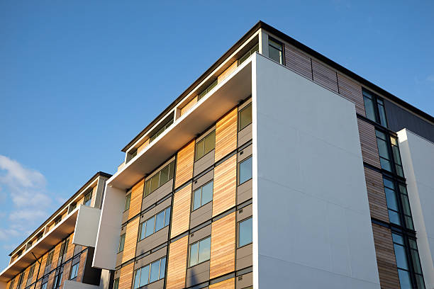 residential apartment with wood panels and blue clear sky - solar panel bildbanksfoton och bilder