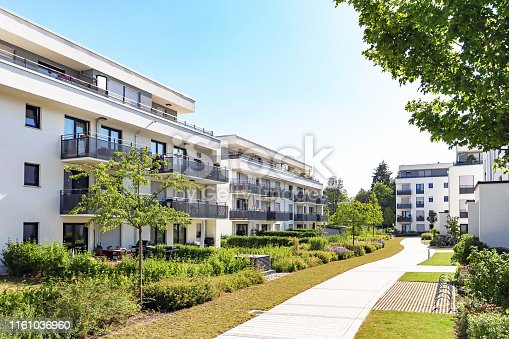 istock Residential area with apartment buildings in the city 1161036960