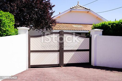 istock residential brown sandy portal home suburb metal aluminum house gate street wall 1283840403
