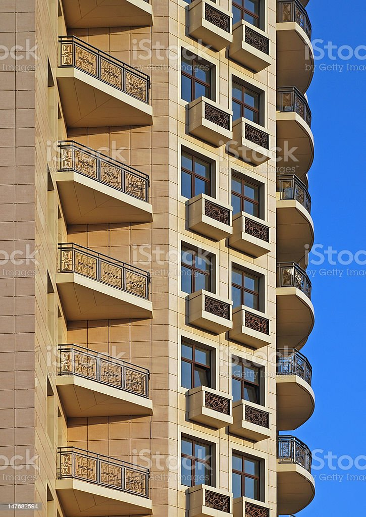 Residential building fragment with balcony rows royalty-free stock photo