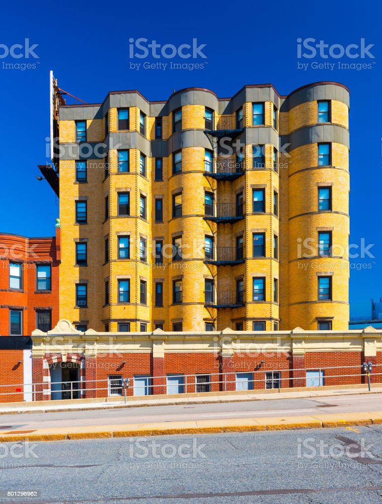Residential building made of yellow bricks. Apartment block in the street of Boston, Massachusetts, USA. Summer day with clear blue sky stock photo