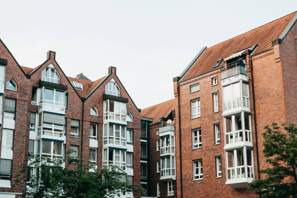 Residential buildings in Muenster in Germany. Residential buildings in Muenster in Germany. Ordinary houses in urban area. Apartment buildings in a row. adjacency stock pictures, royalty-free photos & images
