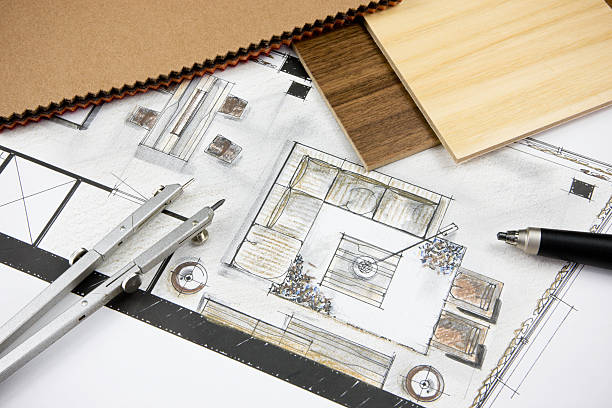 Residential Concept Tools of the trade of the interior designer on top of a just completed 2d interior design drawing showing the colorized concept of living room and dining area, together with color fabric swatches and wood veneer samples. interior designer stock pictures, royalty-free photos & images