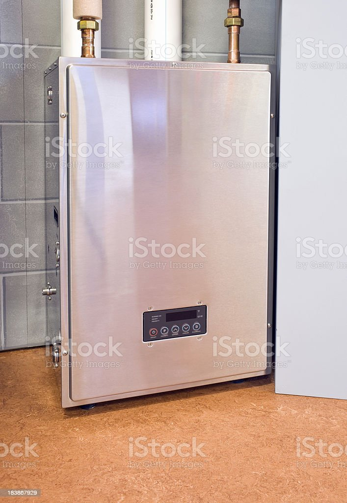 Residential Condensing Hybrid Tankless Water Heater royalty-free stock photo