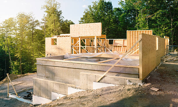 Residential construction site panorama with pool Residential construction site panorama with concrete pool in the foreground man made structure stock pictures, royalty-free photos & images