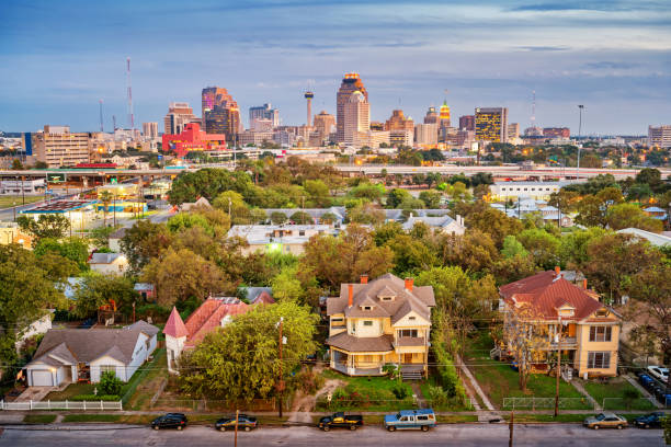 Residential district and skyline of San Antonio Texas USA Stock photograph of a residential district and the downtown skyline of San Antonio Texas USA at twilight. san antonio texas stock pictures, royalty-free photos & images