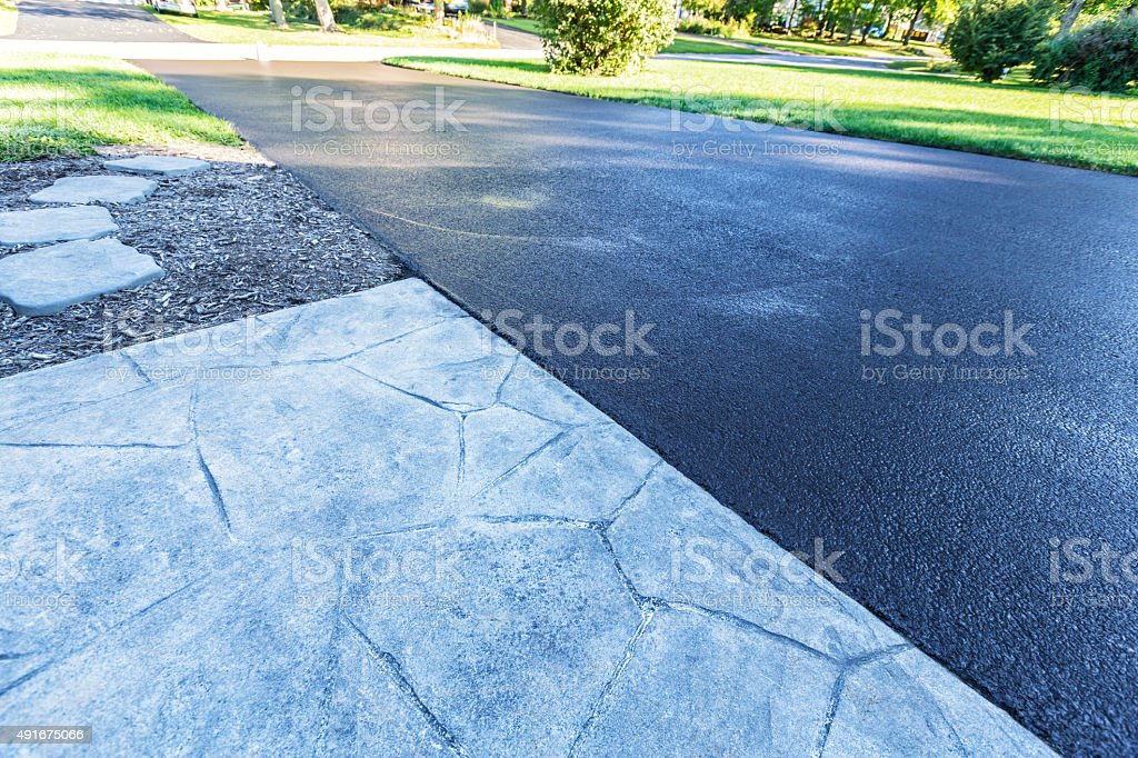Residential Driveway New Blacktop Asphalt Resealing stock photo