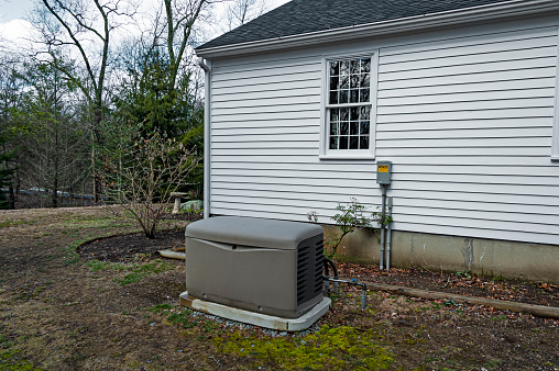 Residential standby generator on a concrete pad