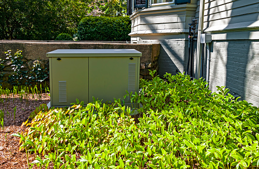 Residential standby generator installed on a concrete pad