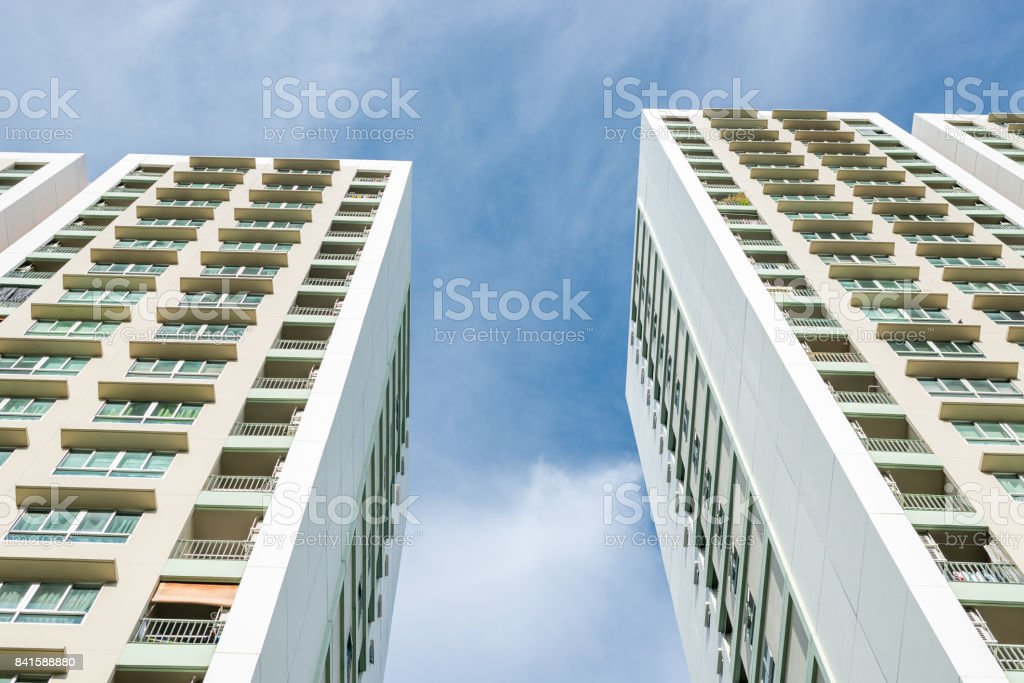 Residential high-rise buildings against blue sky with cloud stock photo