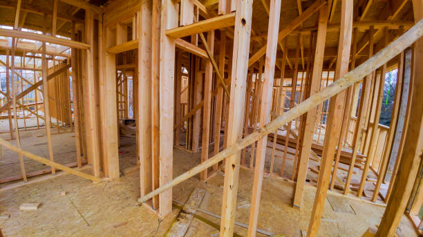 Residential home framing view on new house wooden under construction Residential construction home framing view on new house wooden under construction studded stock pictures, royalty-free photos & images