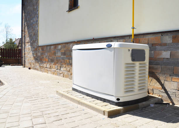 Residential house natural gas backup generator. Choosing a location for house standby generator. stock photo