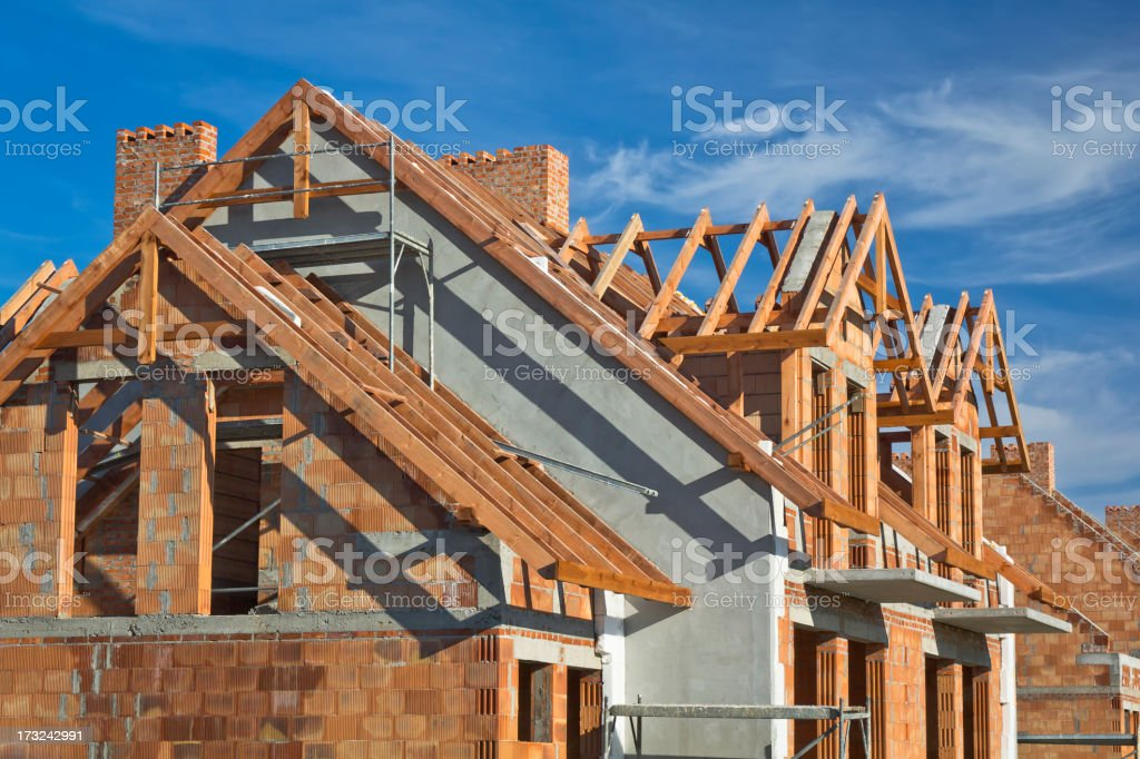 Residential House under construction Residential House under construction against blue sky Architecture Stock Photo