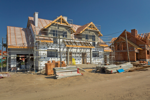 Residential House under construction against blue sky