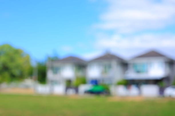 residential house village suburb with grass field playground, image blur background stock photo
