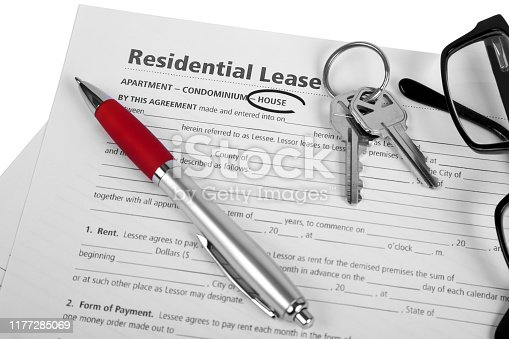 istock Residential Lease for a house with pen, glasses, and keys 1177285069