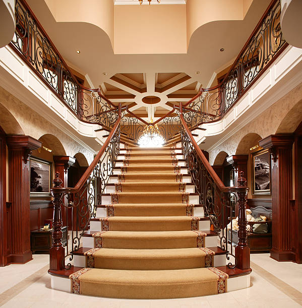 residential luxury stairway in home entrance - stately home stock photos and pictures