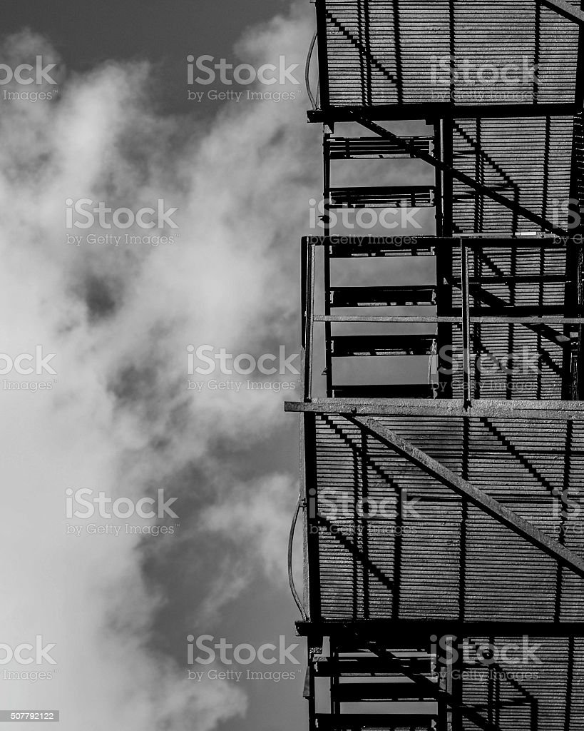 Residential metal staircase in black and white stock photo