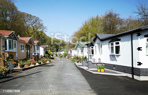 Swansea, UK: April 27, 2019: Residential mobile homes for retired persons only with gardens and car parking spaces.