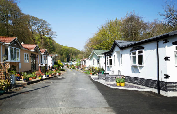 Residential Mobile Homes - UK Swansea, UK: April 27, 2019: Residential mobile homes for retired persons only with gardens and car parking spaces. trailer park stock pictures, royalty-free photos & images