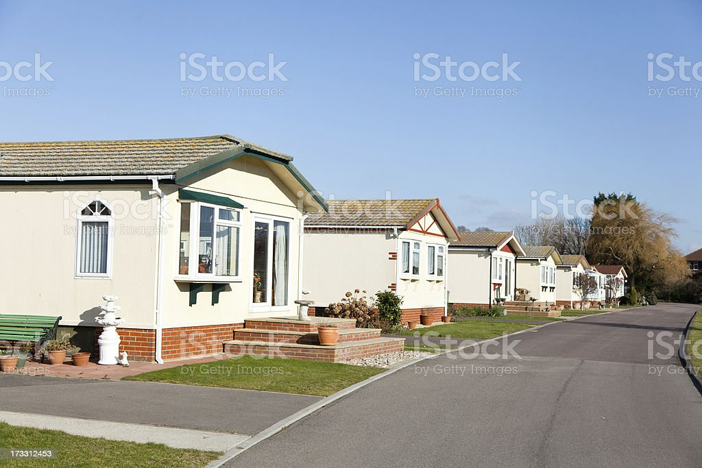 Residential mobile park homes sited in a row. royalty-free stock photo