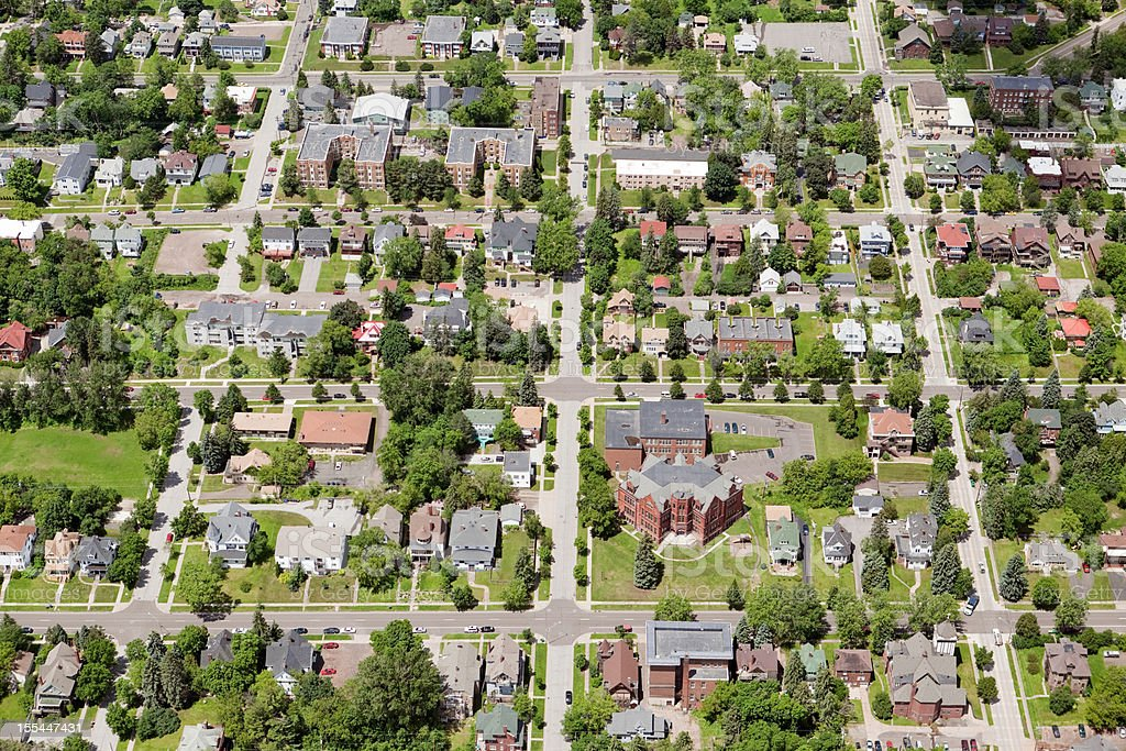 Residential Neighborhood Aerial with Homes and Buildings stock photo