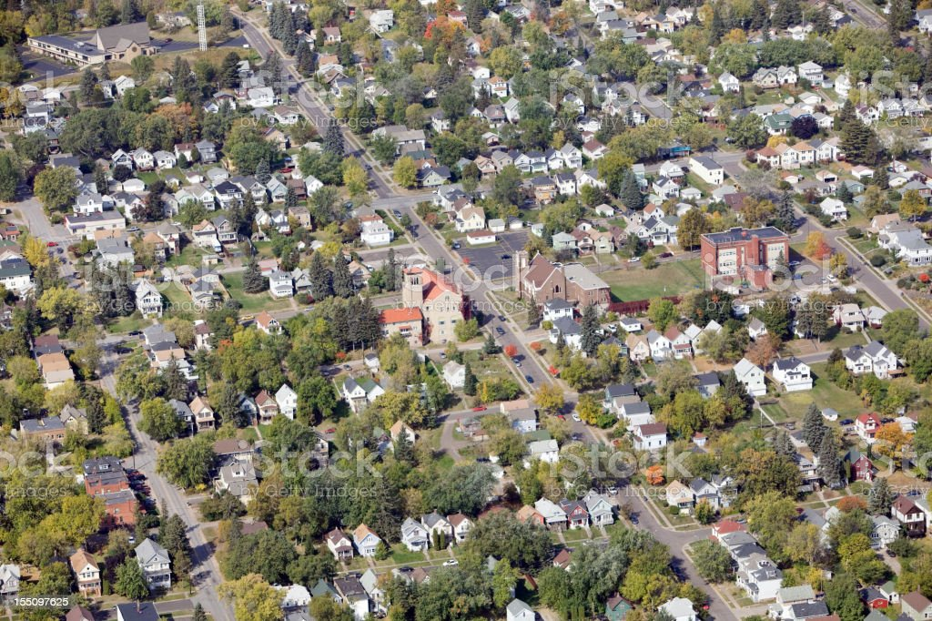 Residential Neighborhood Aerial with Homes, Churches and a School stock photo