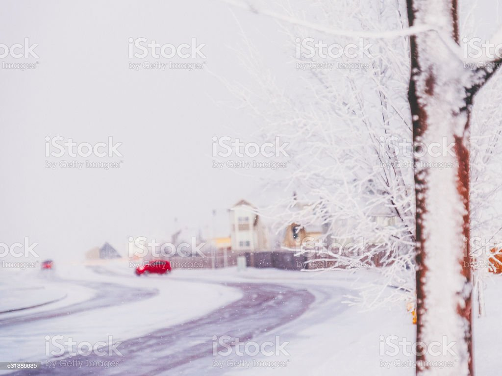 Residential neighborhood in Colorado during heavy snowfall stock photo
