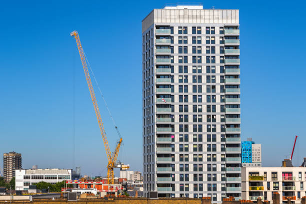Residential new development high rise tower block with a crane in London stock photo