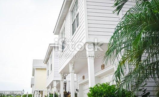 108220043 istock photo Residential pastel townhouses in suburban community neighborhood 1192315866