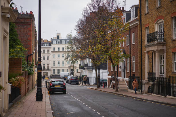 A residential street in Mayfair, an affluent area in the West End of London. London, UK - November, 2018. A residential street in Mayfair, an affluent area in the West End of London. It is one of the most expensive districts in London and the world. mayfair stock pictures, royalty-free photos & images