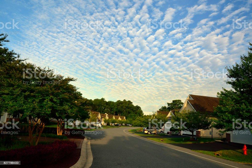 Residential Street Under a Buttermilk Sky stock photo